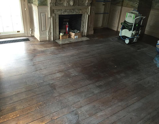 Dustless hardwood refinishing can bring your floors back to live without the hassle of the clean-up project afterwards. Roomscene of a sanded floor awaiting new finish.